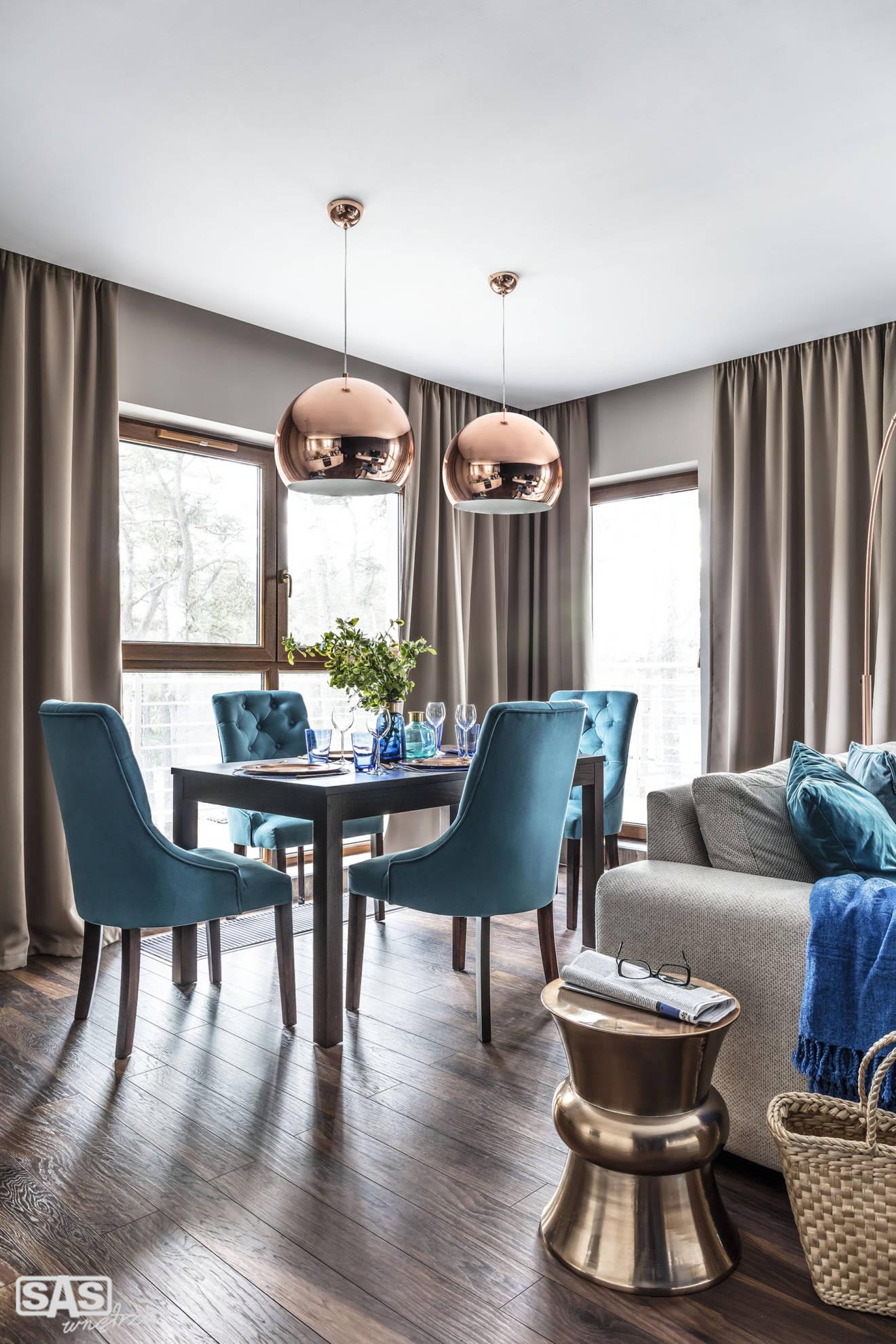 Aranżacja otwartej jadalni połączonej z salonem - projekt architekt wnętrz Emilia Strzempek Plasun.